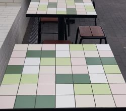 Tables with Tiled Recessed Tops. Powder Coated Steel Surround and Base