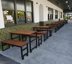 Timber slats on table top and bench seat top. Steel frame bolted to floor – Powder Coated Black